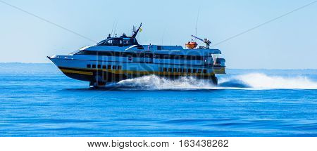 hydrofoil boat runs at full speed on the sea waves