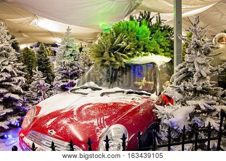 Lacock UK - November 19 2016: red car with Christmas tree on top in Whitehall garden centre