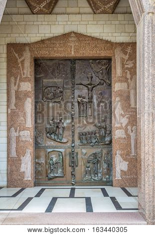 Front double embossed doors of the Basilica of the Annunciation or Church of the Annunciation in Nazareth Israel