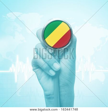 hand holding stethoscope with Republic of the Congo flag.