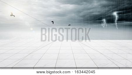 Business concept - Empty marble floor top with panoramic sky view under sunrise and storm thunder grey sky for display or montage product