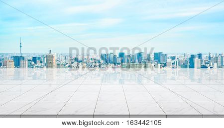 Business concept - Empty marble floor top with panoramic modern cityscape building bird eye aerial view under sunrise and morning blue bright sky of Tokyo skytree Japan for display or montage product