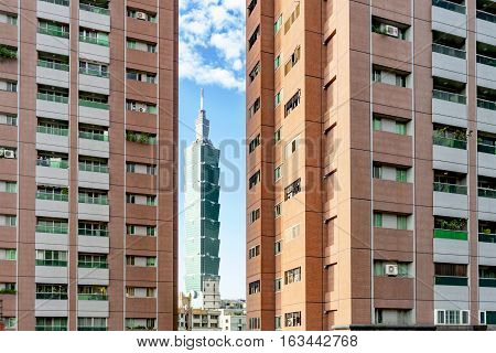 TAIPEI TAIWAN - NOVEMBER 11: View of modern apartment buildings with Taipei 101 in the distance taken from Elephant mountain on November 11 2016 in Taipei