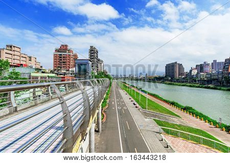 View of Taipei riverside park and architecture