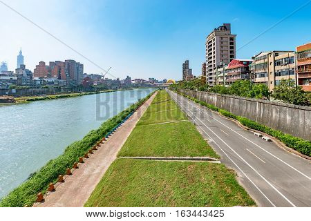 View of Taipei riverside park with architecture on a sunny day