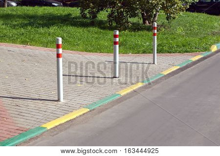 Pillars blocking the entry of vehicles into pedestrian zone in a city