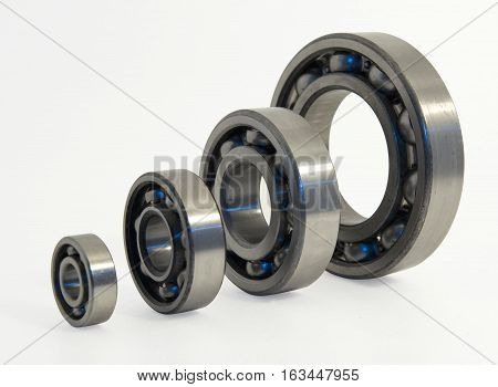 Four ball bearings. A ball bearing is a type of rolling-element bearing that uses balls to maintain the separation between the bearing races.