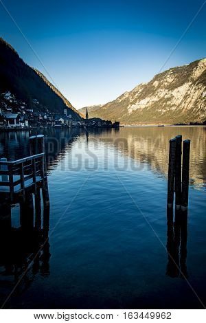 Hallstatt village reflected in lake in the Salzkammergut region of Austria