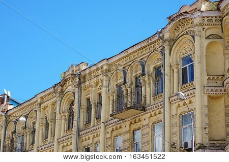 multi-story historic building with windows in city