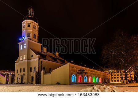 Nesvizh Belarus - December 28, 2016: Night winter view of the illuminated Town Hall in Nesvizh. A monument of architecture of Belarus of XVI-XVIII centuries