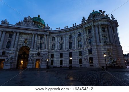 Famous hofburg palace in vienna in the evening, seen from michaelerplatz, austria