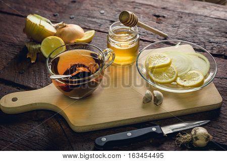 Natural medicines against flue and cold. Honey lemon and garlic. Health and alternative medicine concept.