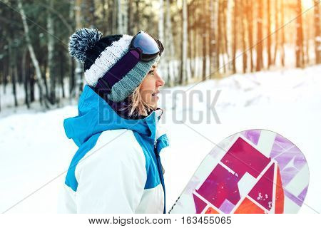 Female Snowboarder Along With Snowboarding Among The Trees