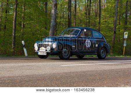 HEIDENHEIM GERMANY - MAY 4 2013: Uwe Jaeger and Hans-Ulrich Jaeger in their 1961 Volvo PV 544 at the ADAC Wurttemberg Historic Rallye 2013 on May 4 2013 in Heidenheim Germany.