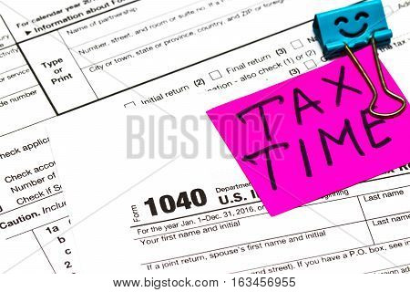 Tax Time Written On A Bright Sticker Note Paper Clip For A Tax