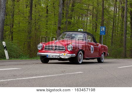 HEIDENHEIM GERMANY - MAY 4 2013: Fritz Wohlfarth and Ulrich Frank in their 1959 Borgward Isabella Coupe Cabrio at the ADAC Wurttemberg Historic Rallye 2013 on May 4 2013 in Heidenheim Germany.