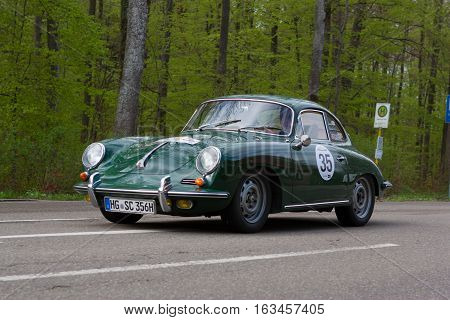 HEIDENHEIM GERMANY - MAY 4 2013: Karl Breyer and Gerd Spothelfer in their 1965 Porsche 356 SC at the ADAC Wurttemberg Historic Rallye 2013 on May 4 2013 in Heidenheim Germany.