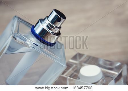 stylish bootle of closeup perfume in wooden background