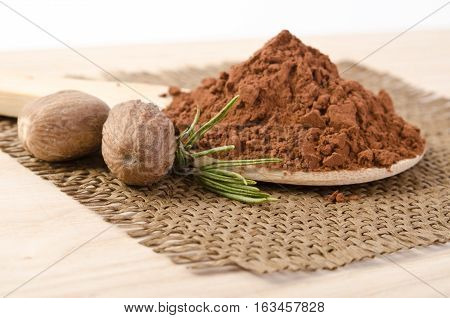 Nutmegs With A Sprig Of Rosemary And Cacao Powder