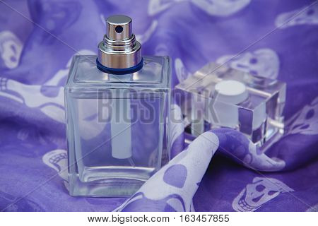 female Bottle of perfume in blue background