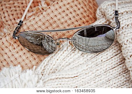 female stylish sunglasses with scarf and hat