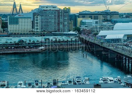 Darling Harbour Sydney Australia at sunset.DEC 30,2016 Darling Harbour is a harbour adjacent to the city centre of Sydney, New South Wales, Australia.