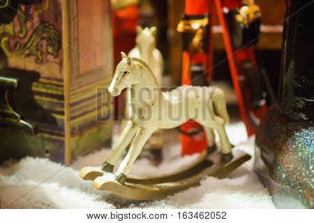 decorative toy horse in snow. clouse up