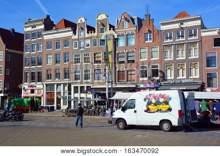 AMSTERDAM NETHERLAND OCTOBER 03 2015: Typical canal Houses . Canal houses usually had a basement and a loft and attic where trade goods could be stored