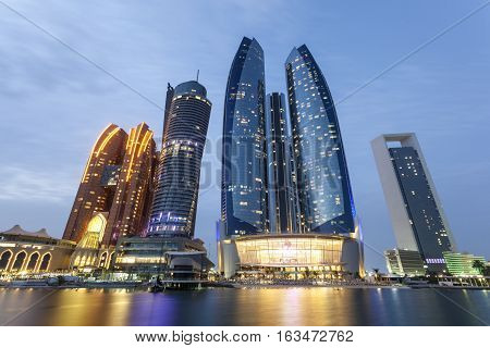 The Etihad Towers in Abu Dhabi illuminated at night. United Arab Emirates Middle East