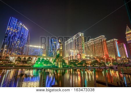 Macau, China - December 8, 2016: scenic view of hotels in Cotai Strip, Crown Towers, City of Dreams, Hard Rock, St Regis, Holiday Inn, Conrad, Sheraton, reflecting on The Venetian's lake in the night.