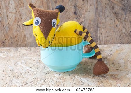Giraffe soft toy on green cup toys for newborn baby