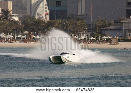 ABU DHABI UAE - NOV 24 2016: White racing boat at the Powerboat Championship 2016 in Abu Dhabi United Arab Emirates