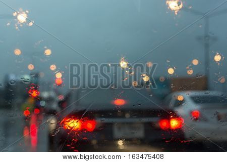Front View Outside Car, Traffic Jam In Heavy Rainy Day On City Street At Night, Abstract Blur Image