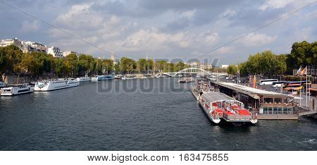 PARIS, FRANCE - OCTOBER 20 2014: Tourist Boat in Paris, France there are several boat tourist trips across the Seine to show tourists the sights of interest.
