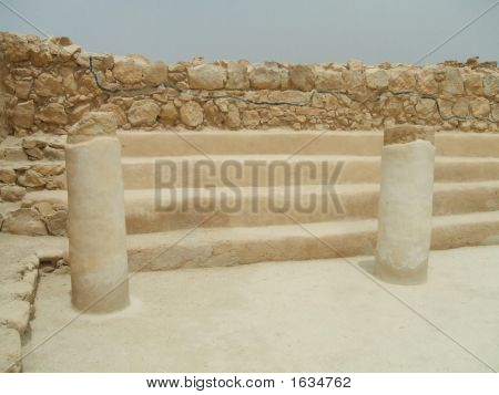 Columns and interior of a room in King Herod's palace in Massada in Israel. Ruins poster