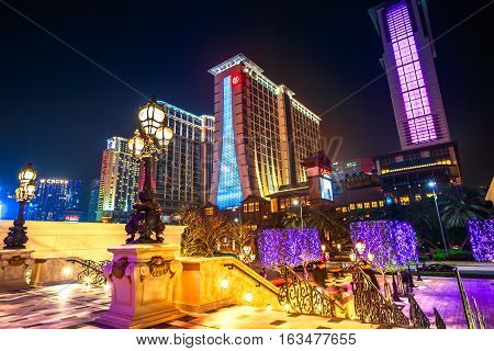 Macau, China - December 8, 2016: aerial view of bright and colorful hotels in Cotai Strip, Holiday Inn, Conrad, Sheraton, from the stairs of The Parisian Hotel Casino in the night.