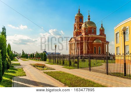 STROITEL BELGOROD REGION RUSSIA - JULE 02 2016: District center in the Belgorod region. Alley overlooking on the current Orthodox church in honor of the New Martyrs and Confessors of Belgorod.