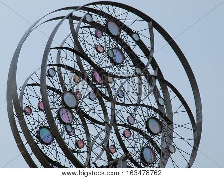 A wind mobile that moves with very little wind movement. The colored glass catches sunlight as it turns. All three spokes move in like and in different directions.