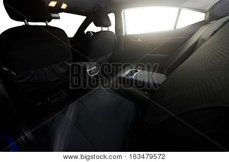Back clear seat of sedan modern car  with isolated windows