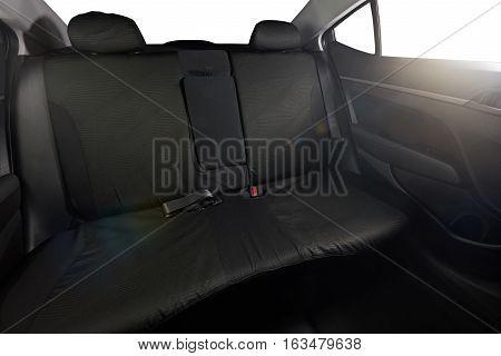 Black back cloth seat of modern sedan car with isolated windows