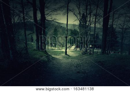 Creepy house in the middle of a dark forest