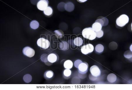 Colorful bokeh backgrund. Black dots texture. White bokeh