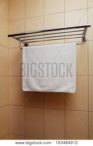 clean dry white towel on a hanger