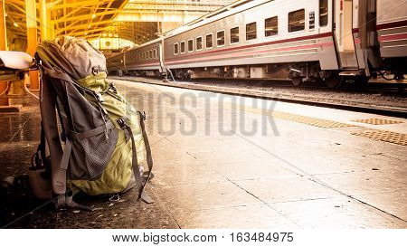 Backpack On The Floor Of Railway Station For Waiting. Travel Bag At The Train Station With Vintage F