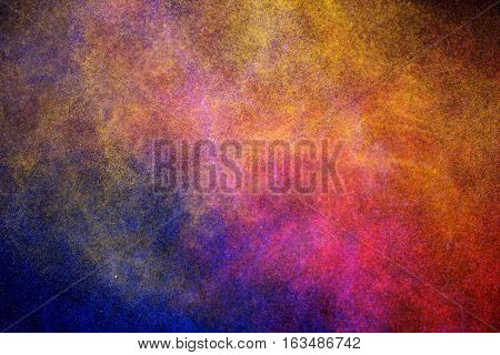 Cosmic colorful dust  shining on dark background