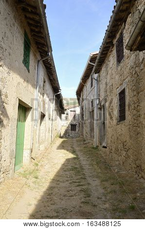 Alleway with stone houses in Candelario a village of the province of Salamanca Spain