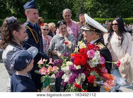 Kiev Ukraine - May 09 2016: Citizens congratulate veterans of the Second World War with the victory anniversary