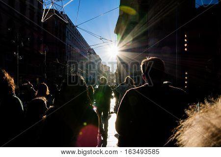 People Walking On Street Sun Flare City Crowd Silhouettes Sidewalk Outdoors Blue Sky Black Anonymous