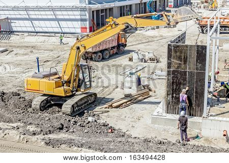 View on building site until workers are assembly a huge mold for concreting.