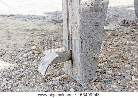 Close up view on pedal of cement mixer safety mechanism machine at construction site.